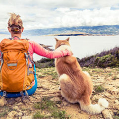 Woman with a dog hiking